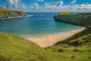 Silver Strand beach is protected by mountains on either side in Ireland