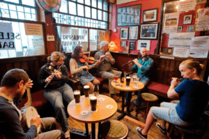 A group of musicians sit around playing music with pints in Ireland