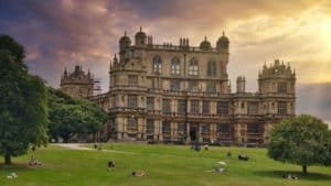 Wollaton Hall stands regal in the distance, illuminated by the sun in Nottingham